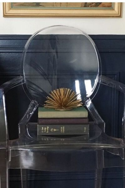 Ghost chair with books and gold sea urchin accessory