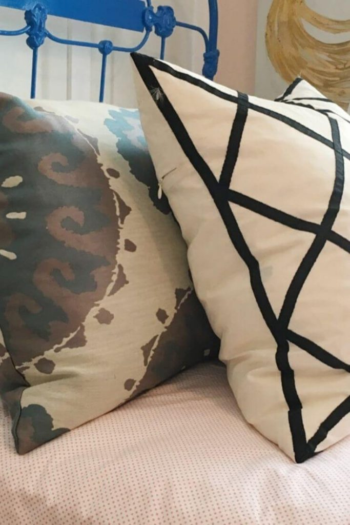 Assortment of pillows on guest bedroom bed.