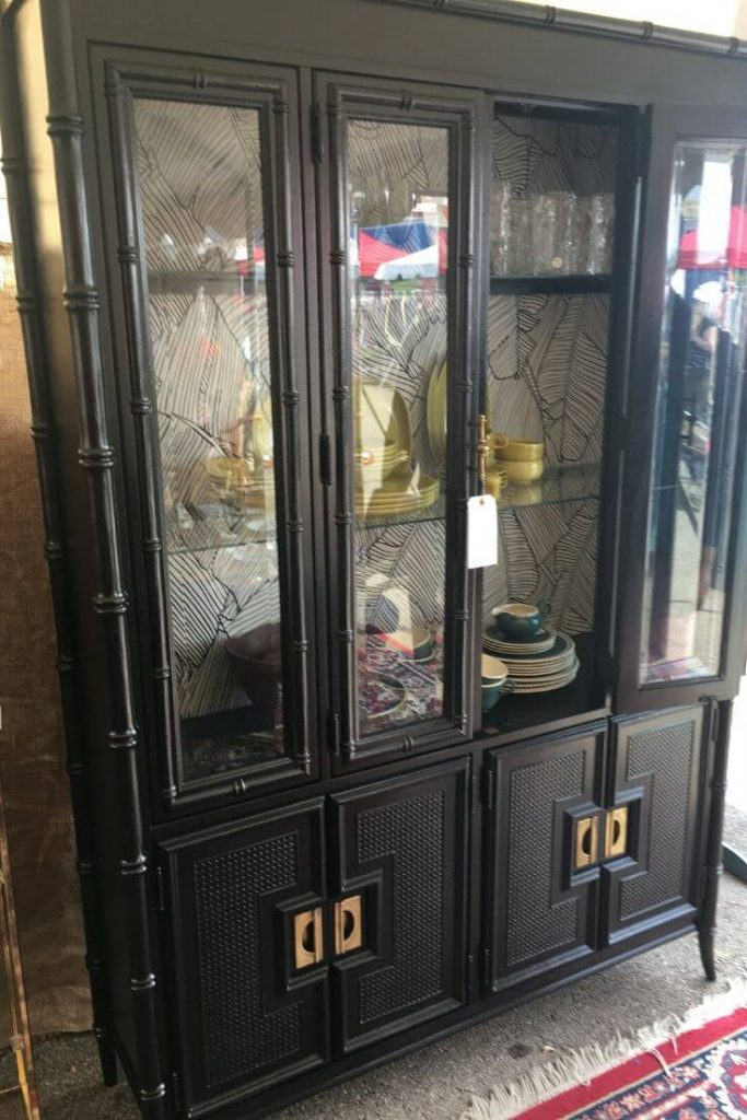Tall black chinoiserie china cabinet.
