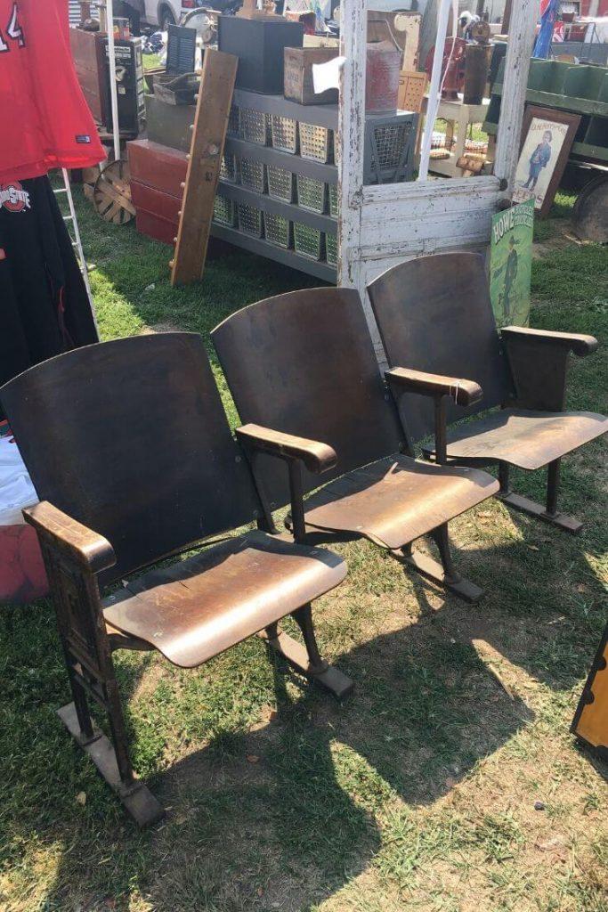 Three wooden stadium seats at the Springfield flea market.