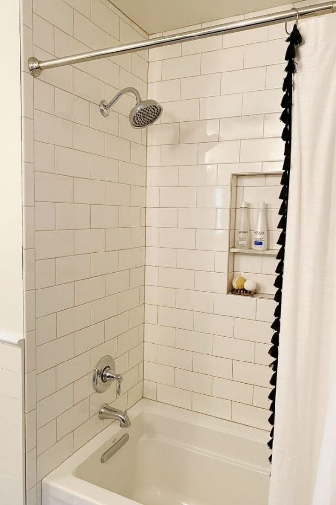 All new shower tile, plumbing fixtures, and a new shower niche after the bathroom remodel