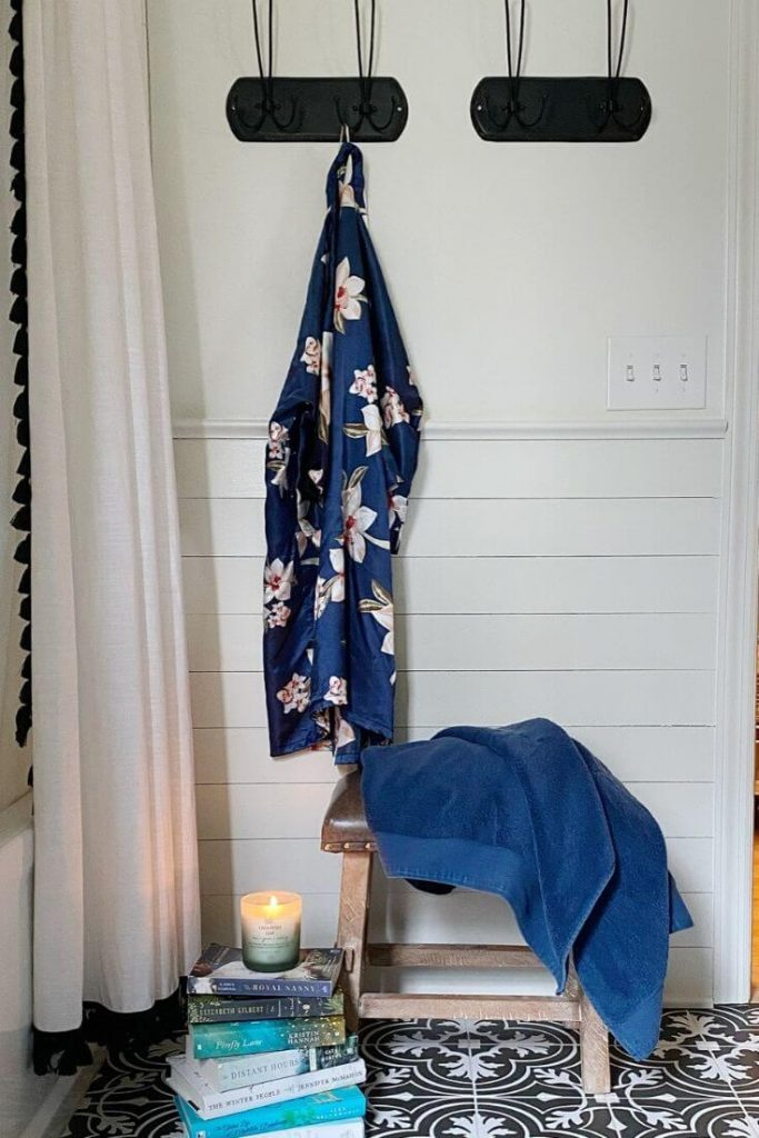 New hooks from Magnolia Market hold towels and robes near the shower for easy access.