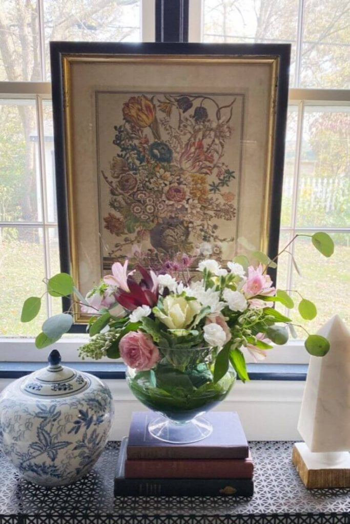 Hang art from your window trim for a  layered design effect