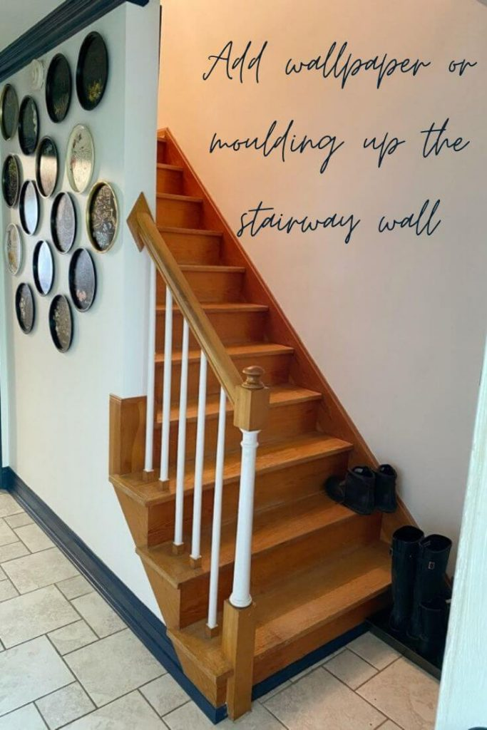 View of our staircase in our entryway where we are considering adding wallpaper or moulding