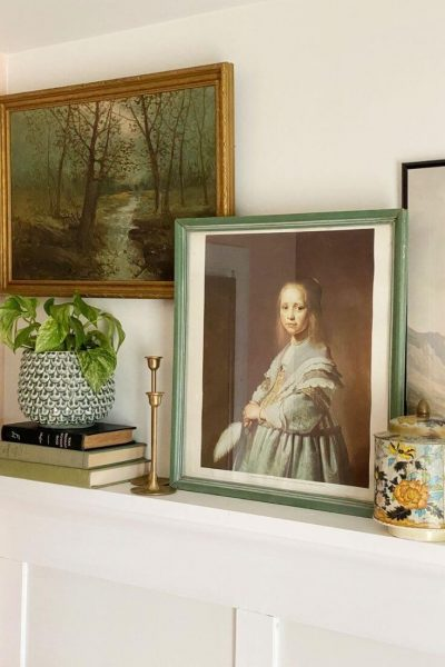 An assortment of old and new accessories and art displayed on a mantle in our guest bedroom to add character to the room.