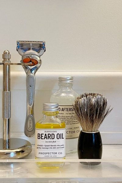 Father's Day gift ideas featuring beard oil, aftershave, razor and holder, and beard brush