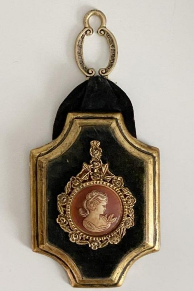 Wall plaque with cameo of young woman