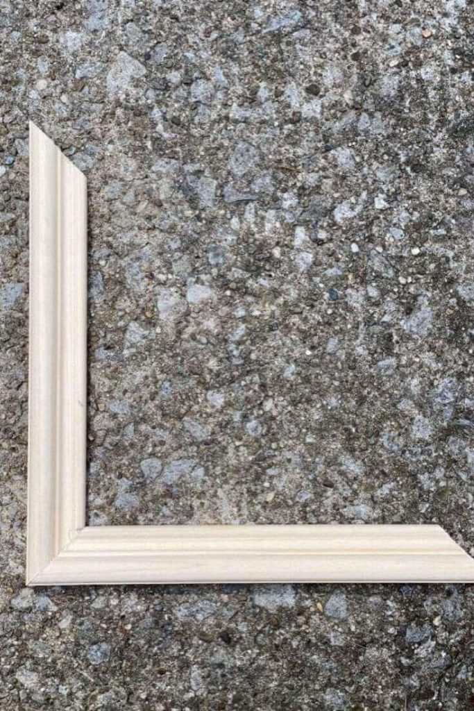 Pieces of base cap moulding cut and pieced together to form the edge of picture frame moulding with rounded edge on the outside