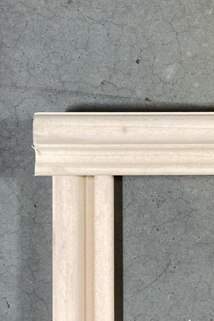 Pieces of uncut base cap poplar moulding butted up perpendicular to each other