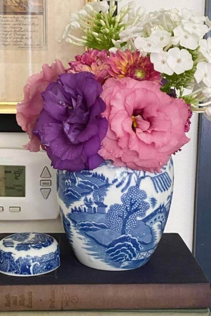 Small blue and white vase with fresh flowers