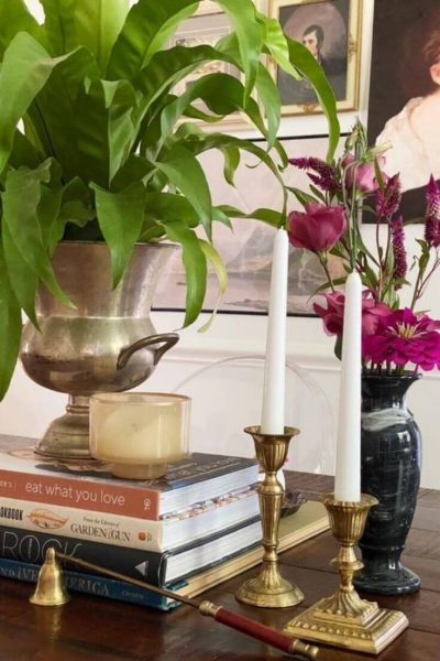 Grouping of accessories, flowers, and a plant on a dining room table