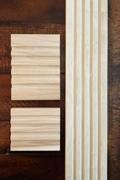 Pieces of poplar wood fluted moulding on wooden table
