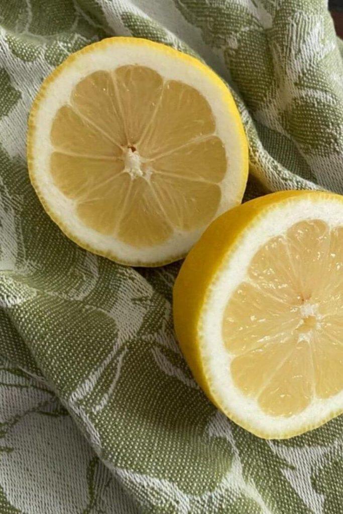 Close up of Lemon cut in halve on green tea towel