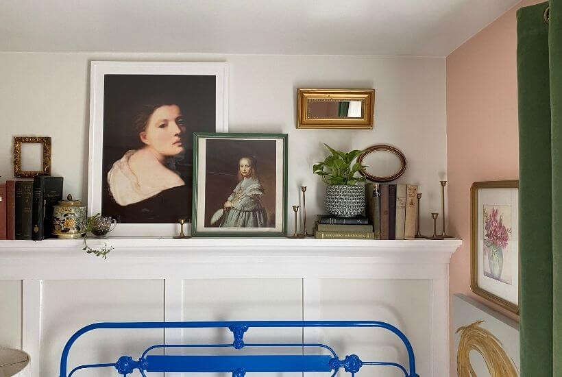 Styles mantel above board and batten wall moulding behind metal blue bed in guest bedroom