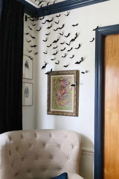 Black 3D bats displayed on a white dining room wall