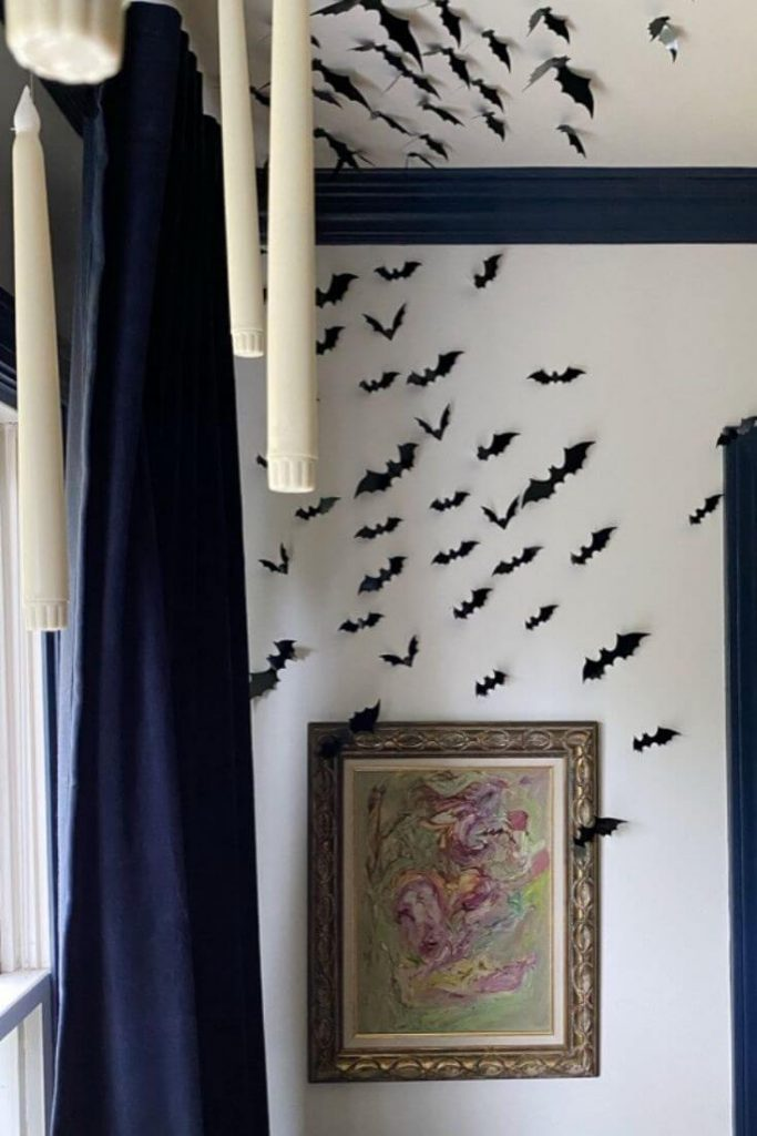 3D black bats displayed on a dining room wall and ceiling for Halloween
