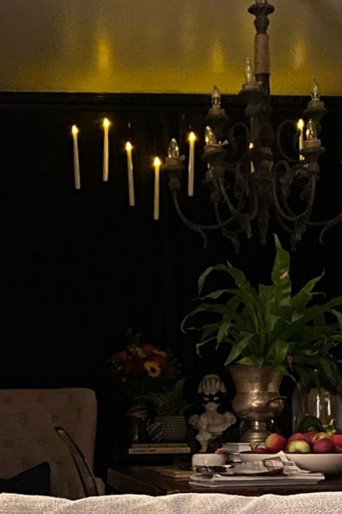 Floating candles hanging in a dining room for Halloween