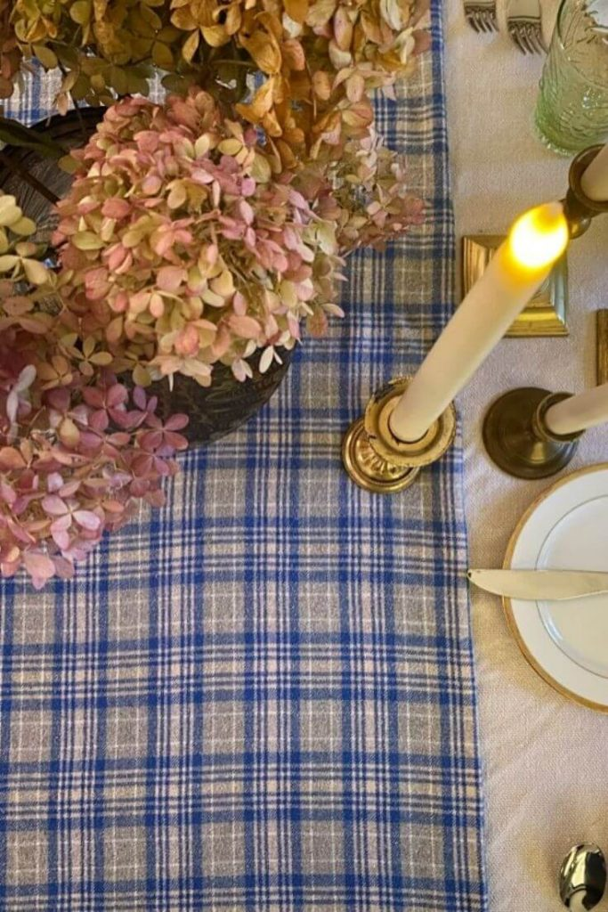 A simple Thanksgiving Day table using a blue and gray flannel throw as a table runner.