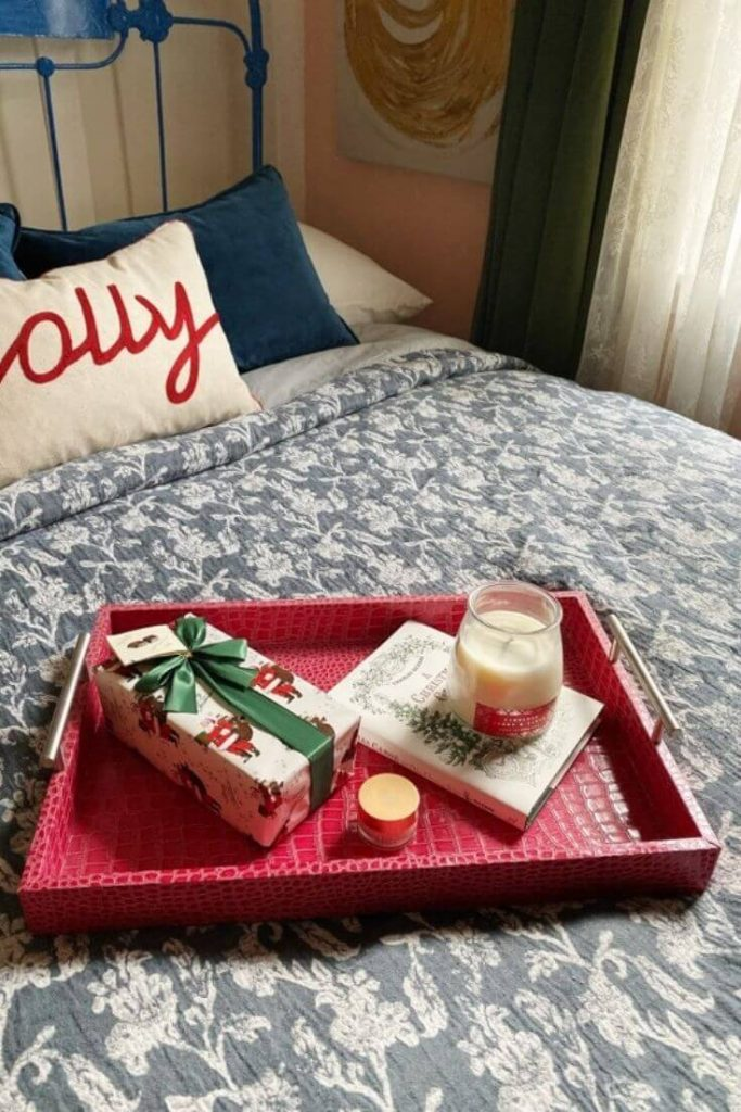 Tray atop a guest bed with Christmas gifts to welcome guests