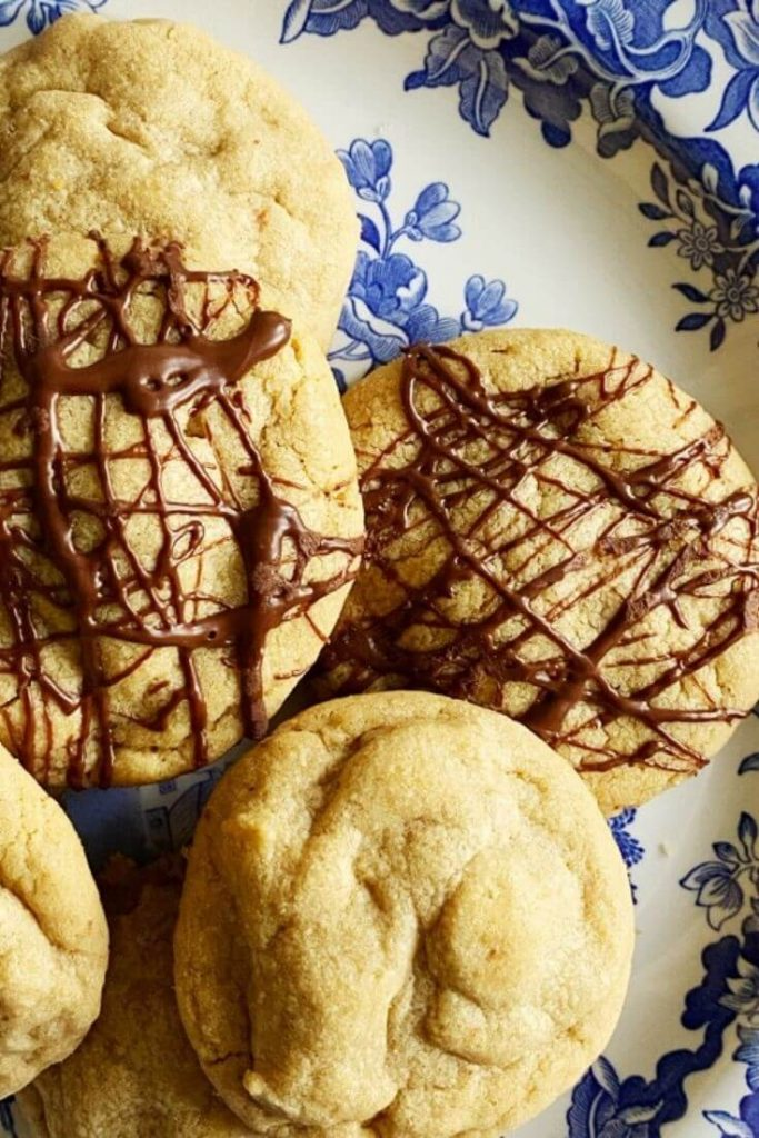 Closeup of Reese's stuffed peanut butter cookies on a blue and white dish
