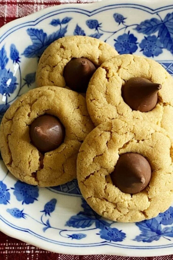 Peanut butter blossom or kiss cookies on a blue and white platter