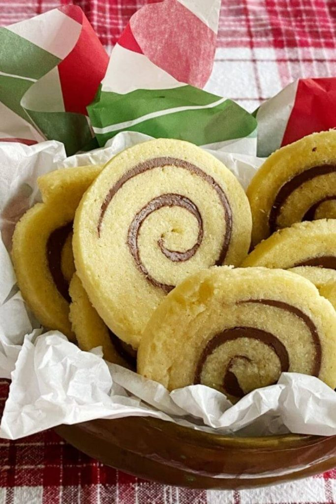 Close up of Nutella pinwheel cookies in a container
