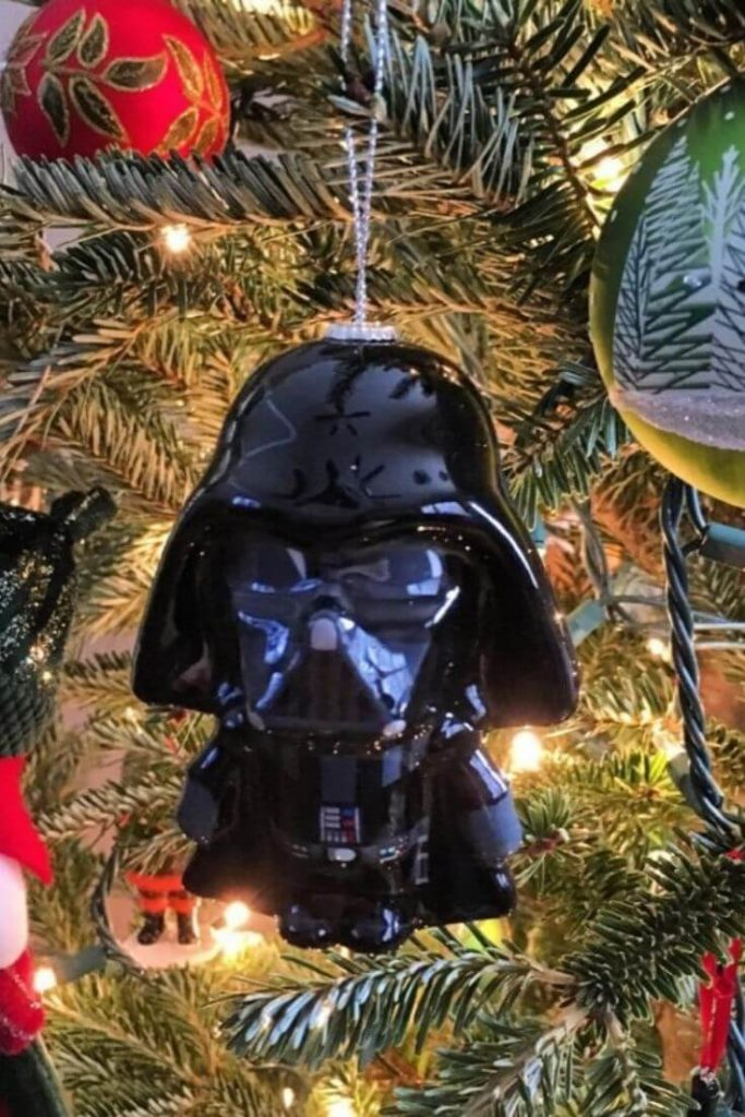 Darth Vadar ornament hanging on a Christmas tree