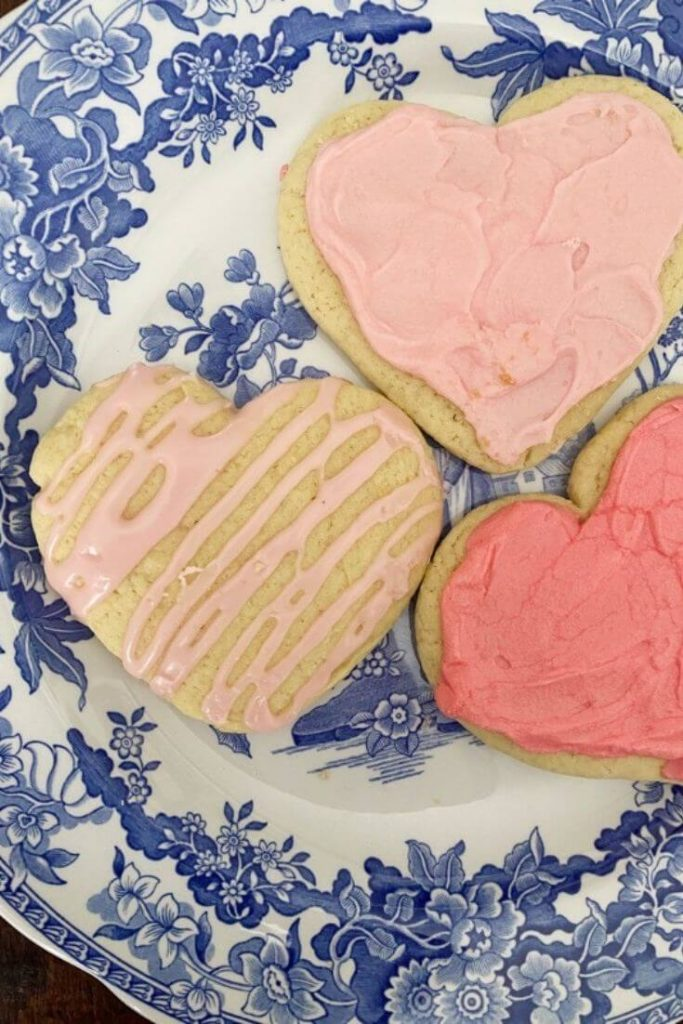 The best heart shaped sugar cookies on a blue and white plate