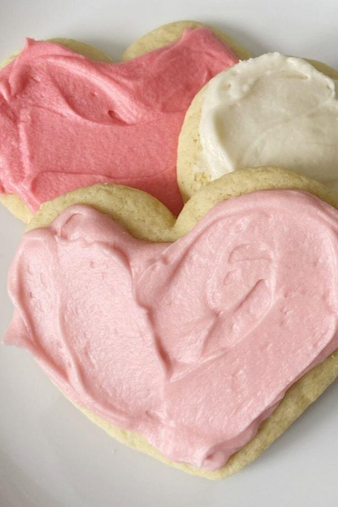 The best sugar cookies are super soft and slightly sweet. Heart shaped cookies on a plate