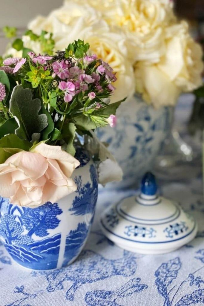Blue and white pottery with fresh flowers is an easy way to decorate your home for spring