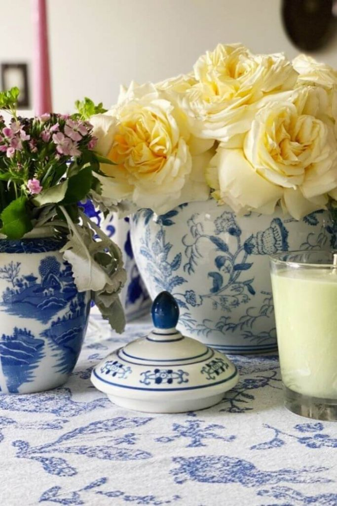 Blue and white pottery vases with fresh flowers grouped together on a dining room table are great Easter table decor