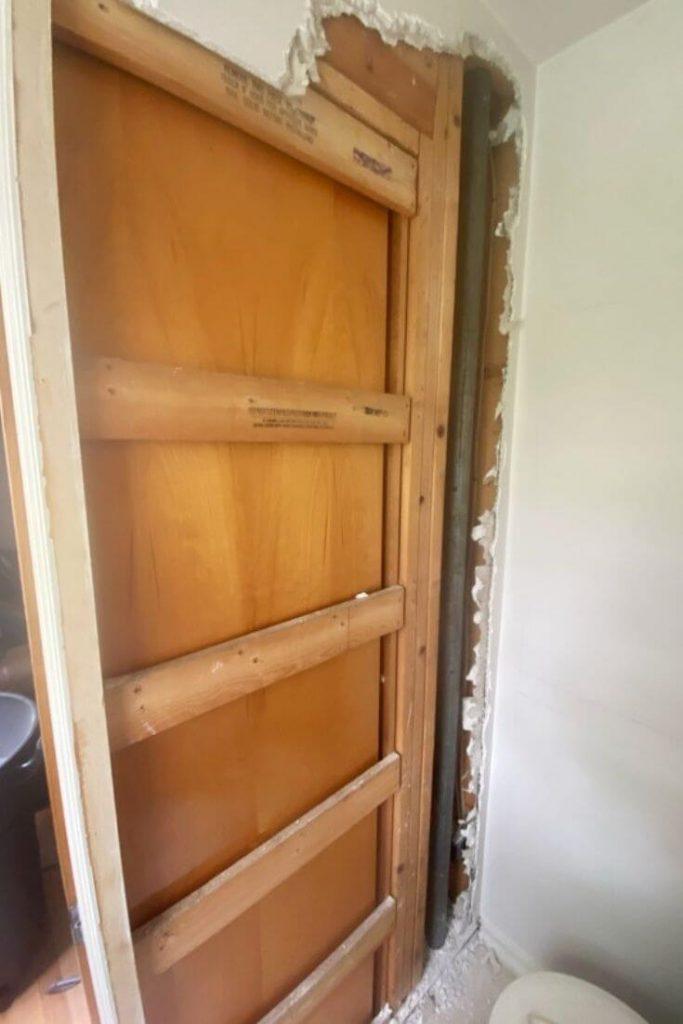 interior framing for pocket door in half bathroom wall