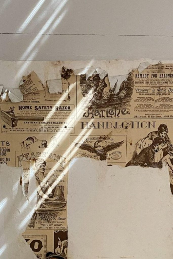 Dated peeling newspaper like wallpaper