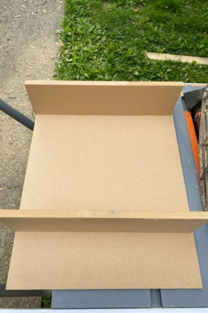Checking the fit of the top and bottom pieces of MDF to the back of the medicine cabinet
