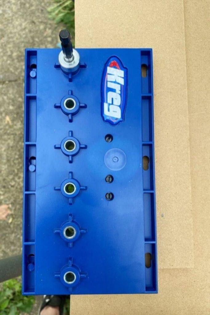 Kreg tool atop a piece of MDF board
