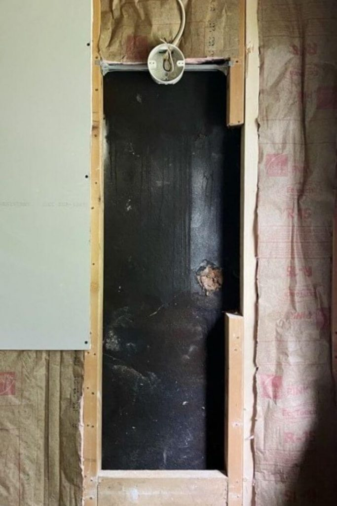 Opening in wall showing space between studs